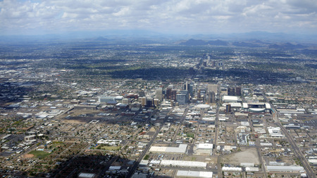 neighboring: Arizona capital city of Phoenix surrounded by neighboring mountains on a rare cloudy day Stock Photo