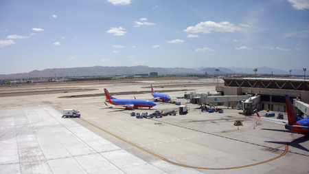 boing: PHOENIX, US - MAY 23, 2015: Boeing-737 airplanes in Canyon Blue Livery of Southwest Airlines on tarmac in Phoenix Sky Harbor Airport, Arizona
