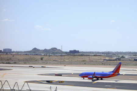 boing: PHOENIX, US - MAY 23, 2015: Boeing-737 in Canyon Blue Livery of Southwest Airlines on tarmac in Phoenix Sky Harbor Airport, Arizona