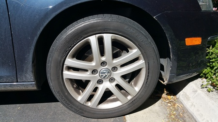bad condition: Los Angeles, CA - March 5, 2015: Extremely bad condition of rubber surface showing deep cracks in Hankook Optimo tire mounted on a front Volkswagen wheel. Label on the tire reads Made in China. Editorial
