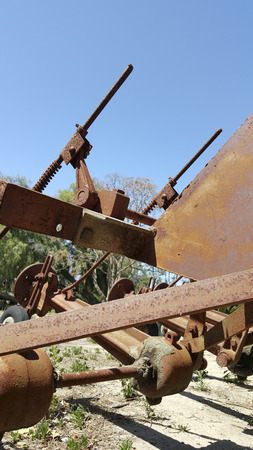 lugs: Details of metal parts of agriculture farmers equipment rusting under the weather elements outdoor