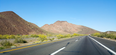 resistant: Buttes and low rise mountains along Interstate-10 east of city of Quartzsite.in Arizona desert covered with drought and extreme heat resistant vegetation. Stock Photo