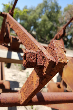 corroded: Corroded metal joints with rusty bolt and nuts of farm equipment