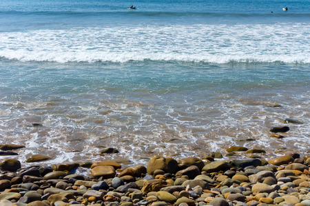 pebbles: Gentle ocean breeze inspires surfers hope for big waves of Ventura coast in Southern California Stock Photo