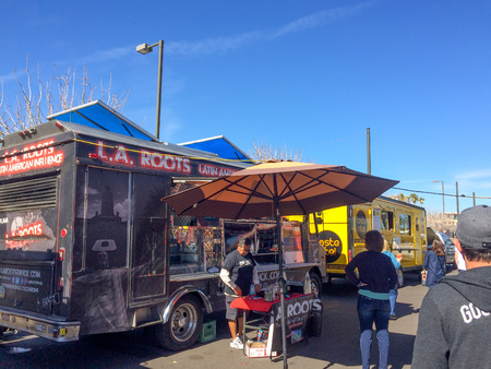 paintjob: PHOENIX, AZ - FEBRUARY 5, 2016: People checking L.A. Roots Latin American Influence food truck with hot and spicy meals at designated spot in downtown of Phoenix, AZ