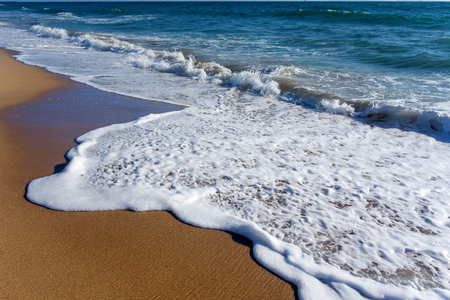 ocean wave: Sparkling white wave suds rolling over yellow sand by ocean breez at Mandalay beach, Oxnard, Ventura county, Southern California Stock Photo