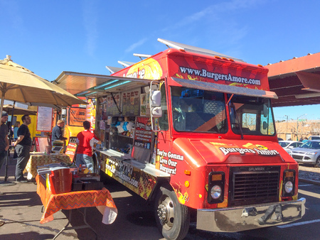 lunch meal: PHOENIX, AZ - FEBRUARY 5, 2016: Lunch goes buying and waiting for meal from Burgers Amore food truck at designated outdoor spot in downtown of Phoenix, AZ