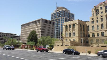 az: PHOENIX, AZ - JULY 29, 2016: Government buildings rising above Cesar Chavez Memorial Plaza at Jefferson Street in Phoenix, AZ Editorial