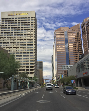 goldish: PHOENIX, AZ - NOVEMBER 3, 2016: Wells Fargo Bank at Central Avenue as seen from Jefferson road in crowded downtown of major Arizona city of Phoenix Editorial