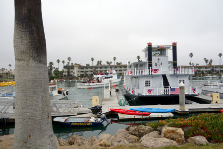 OXNARD, CA, USA - JULY 4, 2013: Island Packers with tourists and Scarlett Belle double decker recreational ship in City of Oxnard marina decorated for 4th of July celebration, Ventura county, Southern California coast
