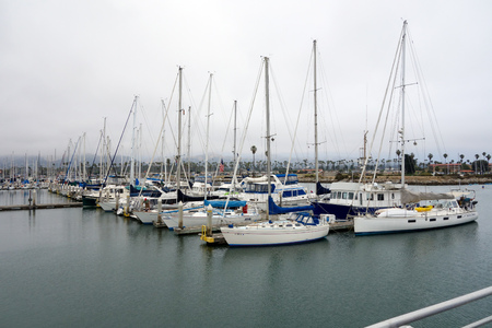 VENTURA, CA, USA - JULY 4, 2013: Recreational and fishing boats at the dock in Oxnard marina, Ventura county, Southern California Pacific coast; copy space