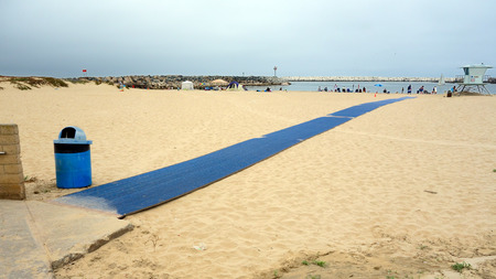 VENTURA, CA, USA - JULY 4, 2013: Blue welcome carpet strip for beachgoers to enjoying holiday at Ventura city beach near Harbor Village, Southern California Editorial