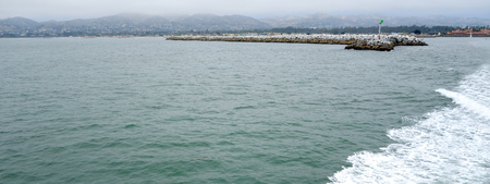 Panorama of Ventura and harbor as seen from ocean side, San Buenaventura, Southern California