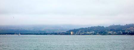 City and Ventura harbor as seen from ocean side, San Buenaventura, Southern California
