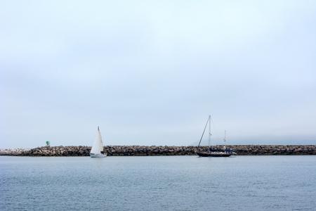 Yachts anchored at breakwater in  at Ventura Harbor, port of San Buenaventura, Southern California