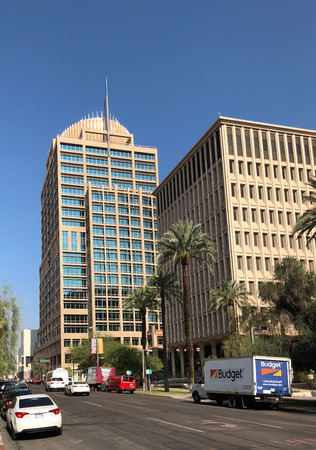 PHOENIX, AZ, USA - DECEMBER 14, 2017: Distinctive architecture of Phoenix City Hall vs municipal building of Calvin Goode as seen from 3rd Avenue and Jefferson Street in Phoenix downtown, Arizona