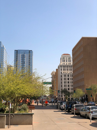 PHOENIX, AZ, USA - DECEMBER 14, 2017: Jefferson Street running East along historic 100 year old high rise buildings and modern skyscrapers in Phoenix downtown, Arizona Publikacyjne