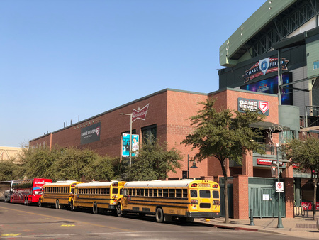 PHOENIX, AZ, USA - DECEMBER 14, 2017:  Charter and school buses closely parked for a special event at Chase Field in Phoenix downtown, Arizona