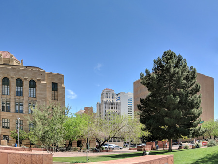 PHOENIX, AZ, USA  - MARCH 28, 2018: Cozy little green park near historical Phoenix City Hall and Luhrs Tower in background, Phoenix downtown, Arizona
