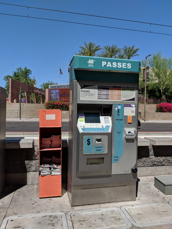 PHOENIX, AZ, USA - APRIL 17, 2018: Valley Metro Light Rail and Buss passes vending machine with validation device 報道画像