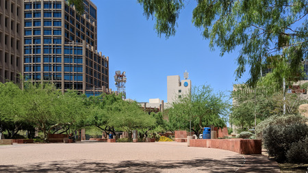 PHOENIX, AZ, USA - MAY 23, 2018:  Cozy small downtown park between new and old Phoenix City Halls provides relaxing and protective shade from scorching mid-day Arizona sun Publikacyjne