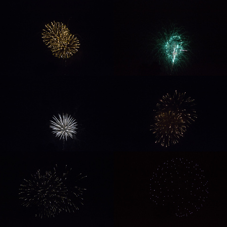 Sparkling round fireball charges exploding in pitch black sky of 4th of July celebration night Stock Photo