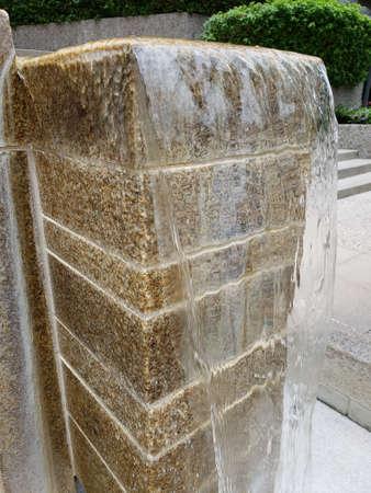 Free flowing water from vertically stacked blocks Zdjęcie Seryjne - 104595784