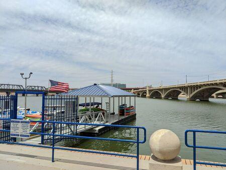 TEMPE, AZ, USA - MAY 21 2018:  Recreation boat rental dock near Mill Avenue bridges at Sail River Lake, Tempe, AZ