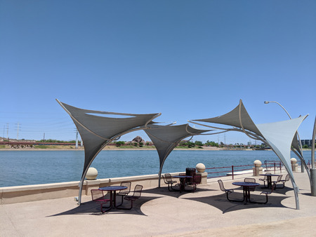 Awnings shielding recreation area from merciless hot sun at Salt River lakeside in Tempe, Arizona; copy space