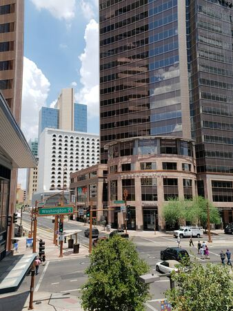 PHOENIX, AZ - JULY 12, 2018: Crossroad at Central Avenue and Washington Street, starting point for roads numbering  in Phoenix downtown,  Arizona capital city Publikacyjne
