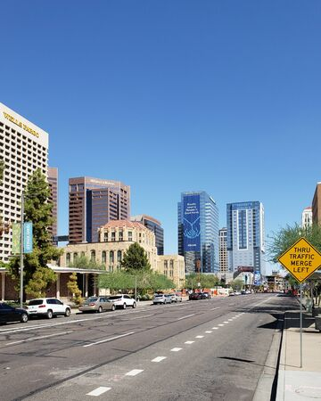 PHOENIX, AZ, USA - SEPTEMBER 21, 2018:  Historic Phoenix City Hall and modern skyscrapers along West Jefferson Street in Phoenix downtown, Arizona capital city