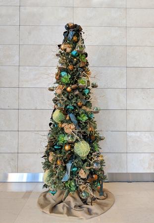 Barrel cacti used as ornaments hanging on Christmas tree Zdjęcie Seryjne