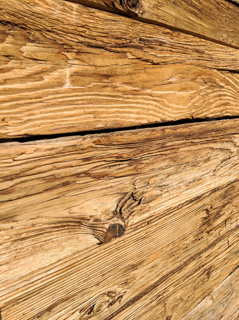 Weathered wooden wall made of split logs with eye sockets, textured natural background Zdjęcie Seryjne - 115271432