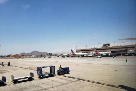 PHOENIX, AZ, USA - JUNE 12, 2019: Airplanes painted in American Airlines livery parked at Terminal 4 in Phoenix Sky Harbor International Airport.