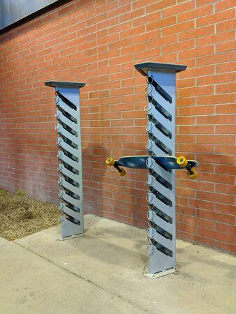 Convenient racks for holding skateboards and scooters outdoor storage or parking