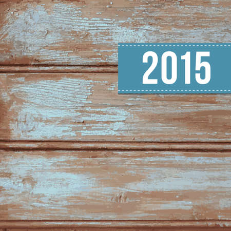 peeling paint: Wooden background with old blue peeling paint and label with 2015
