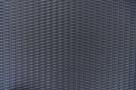 Gray brown synthetic rattan texture weaving background