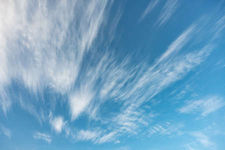 fluffy cirrus and stratus clouds in the blue sky 스톡 콘텐츠