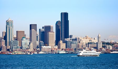 Seattle city skyline from across the water, shows ferryand waterfront
