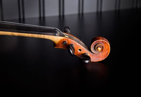 violins: Neck and scroll old violin Stock Photo
