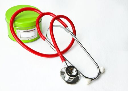 Secret Ingredient for Good Health: Red stethoscope, green ingredient can with label for text, on white background. Lots of room for copy, plus you can insert  text in label area.