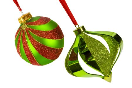 Two Christmas ornaments suspended from red ribbon at an angle, isolated on white Stock Photo
