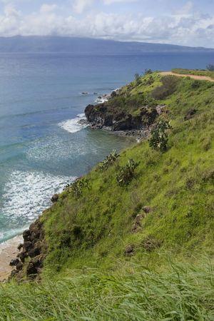Steep green cliffs above beautiful Honolua Bay on Maui, Hawaii  Stock Photo