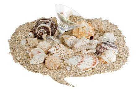 Sand in the shape of a talk buble with seashells and small martini glass, isolated on white Stock Photo