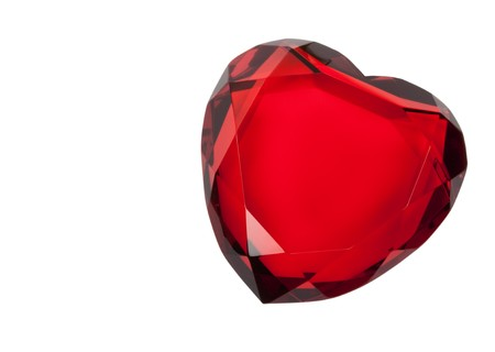 Red cut glass heart paperweight isolated on white