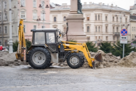 Ukraine agrimotor cleans the street of snowaction photo
