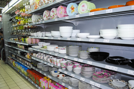 shoppingcarts: crockery on shelves in market