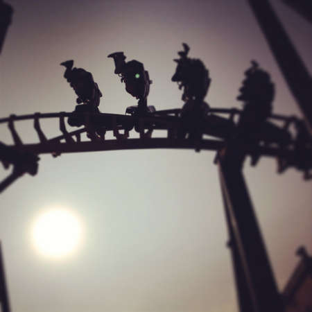 Rollercoaster looping with sun in backround Фото со стока - 21846611