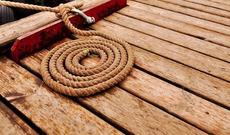 Marine rope spiral on wooden deck  photo