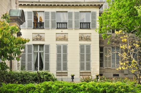 renovate old building facade: Classic french house in Paris